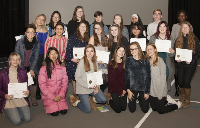 Group of students who won Scholastic Art Awards holding their certificates.