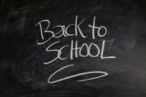 This is an image of a blackboard and the words back to school