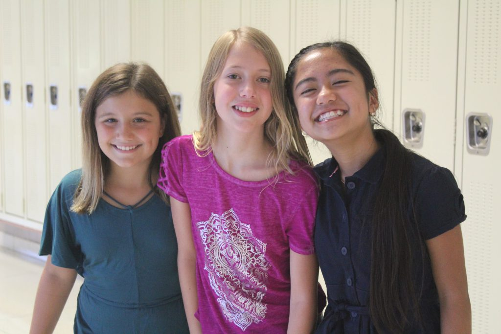 This is an image of three female students smiling for the camera