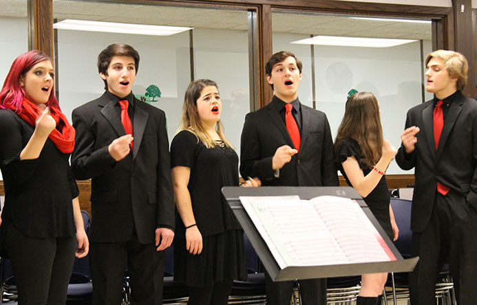This is an image of five students singing at a recent board of education dinner