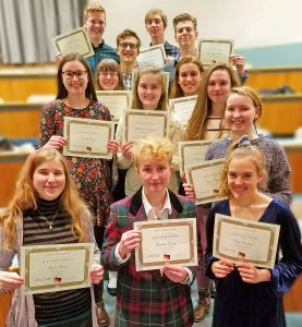This is an image of the German Honor Society members holding certificates and smiling
