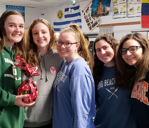 This is an image of five F-M High School students smiling and holding gifts