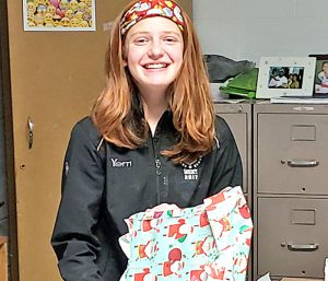 This is an image of an F-M High School student holding a gift and smiling