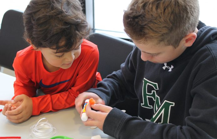 This is an image of two students working together
