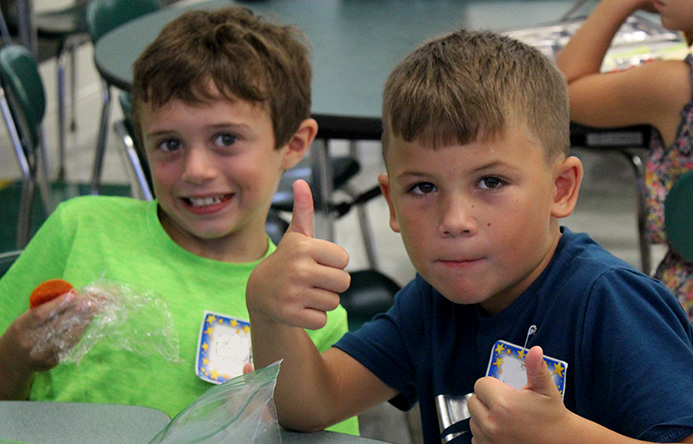 This is an image of two Enders Road students smiling during lunch