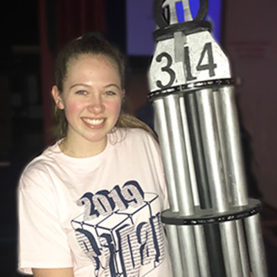 This is an image of Becca Ziobro holding the Pi Day trophy