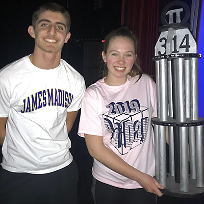 This is an image of Becca Ziobro and Jack Hannah holding the Pi Day trophy