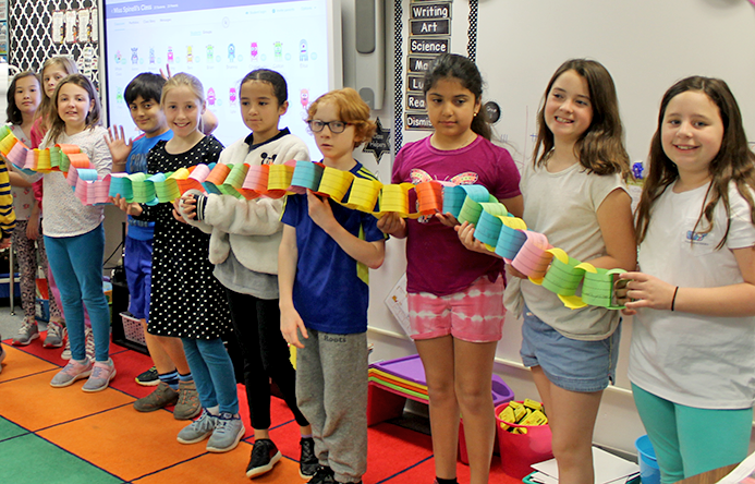This is an image of students holding the paper kindness chain