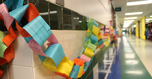 This is an image of a paper chain hanging in a hallway