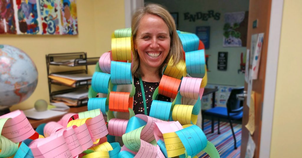 This is an image of Principal Capri holding a paper chain
