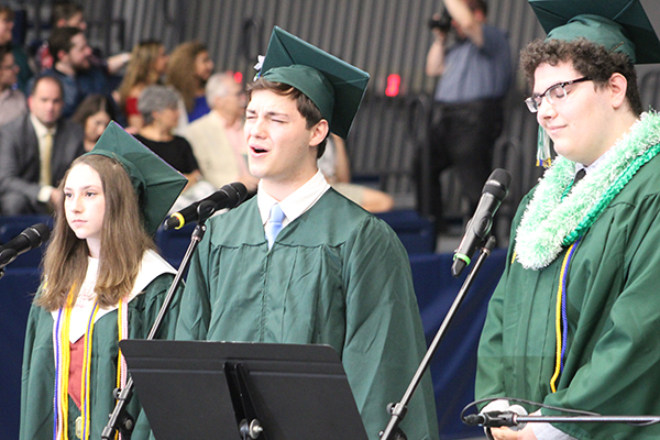 This is an image of three students singing