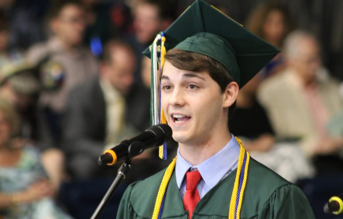 This is an image of a student singing at graduation