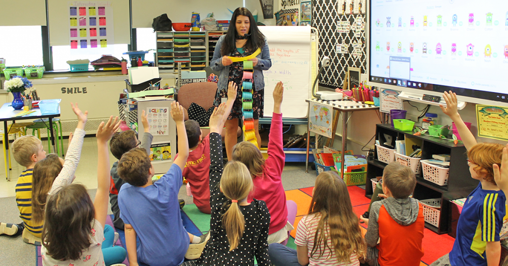 This is an image of students making a paper chain