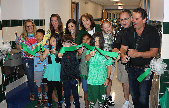 This is an image of students and staff members cutting a ribbon