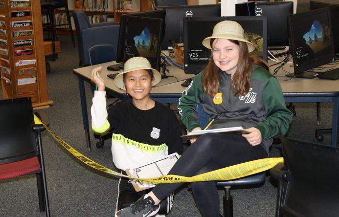 Two students smiling at camera