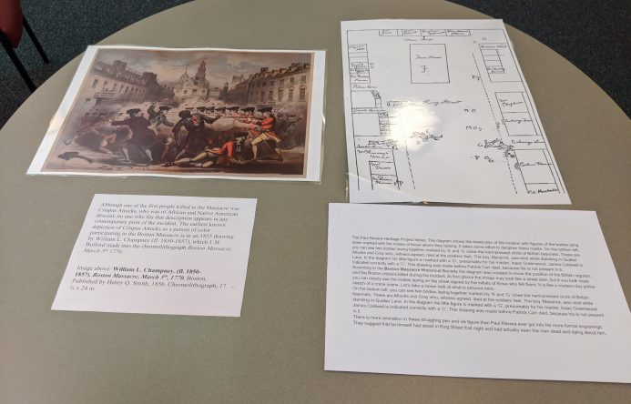 Photos and written descriptions laid out on table.