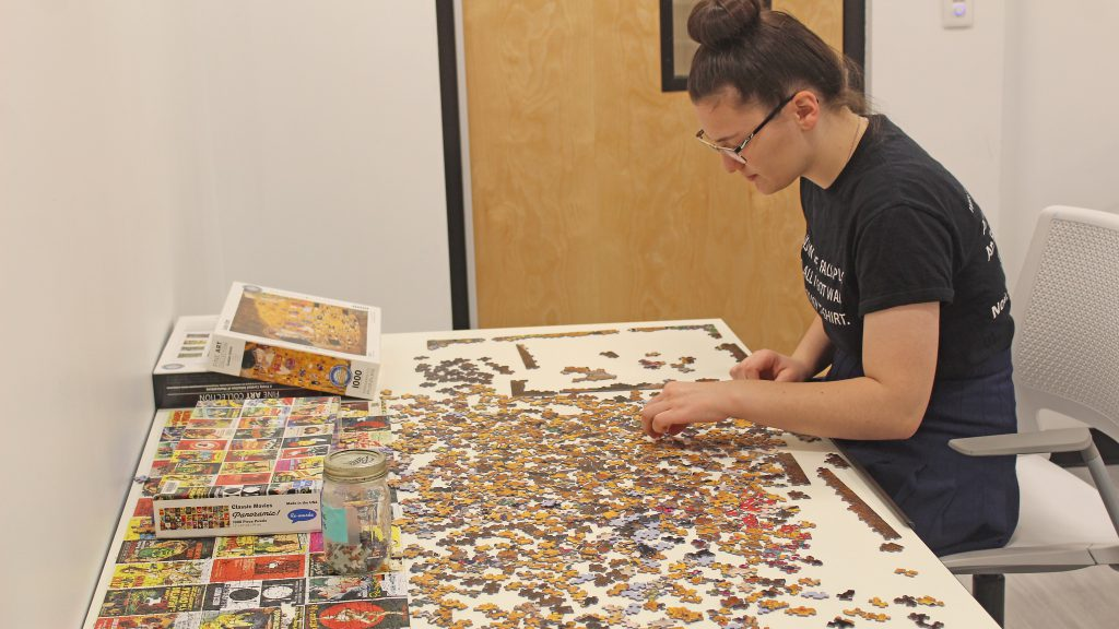 This is an image of a student working on a puzzle