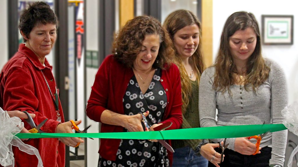 This is an image of students and staff cutting a ribbon