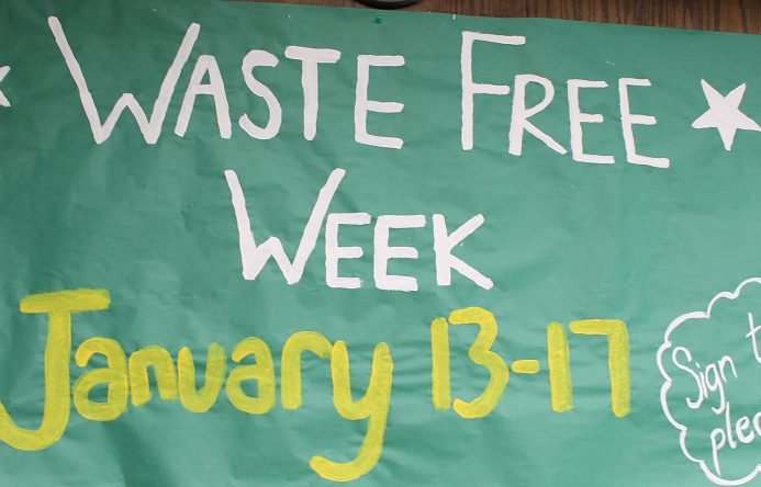 Hand painted ssign that says Waste Free Week, January 13-17; sign the pledge