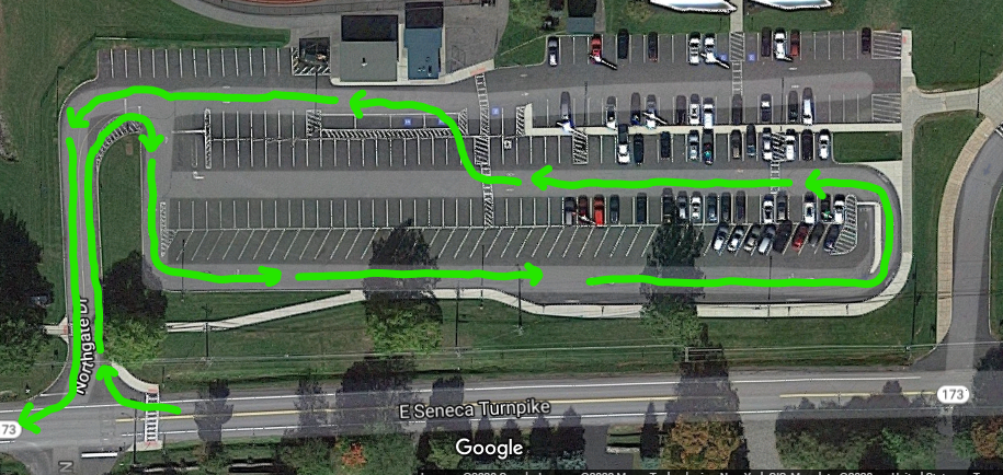 Lines showing the driving route through the high school parking lot.