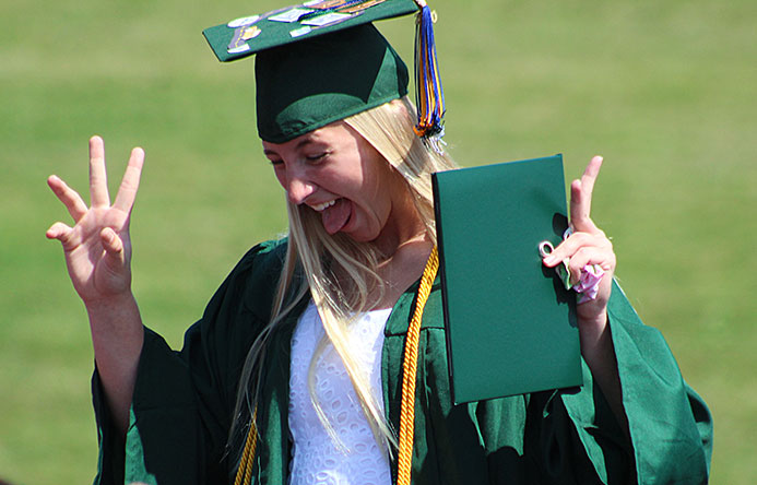 This is an image of a graduate laughing
