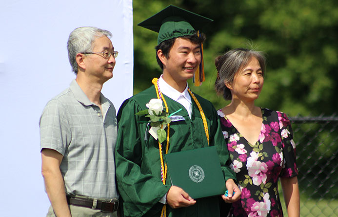 This is an image of a graduate with family members