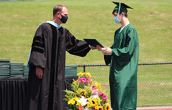 This is an image of a graduate receiving a diploma