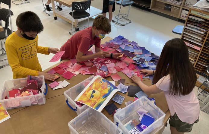 Students sorting colored squares.